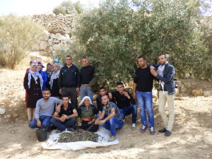 Students from Yatta University together with members of the South Hebron Hills Popular Commitee, in At Tuwani village.