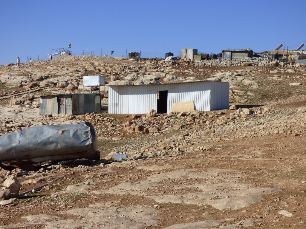 One of three new tin-plated shelters recently provided by the European Union and already under demolition order.