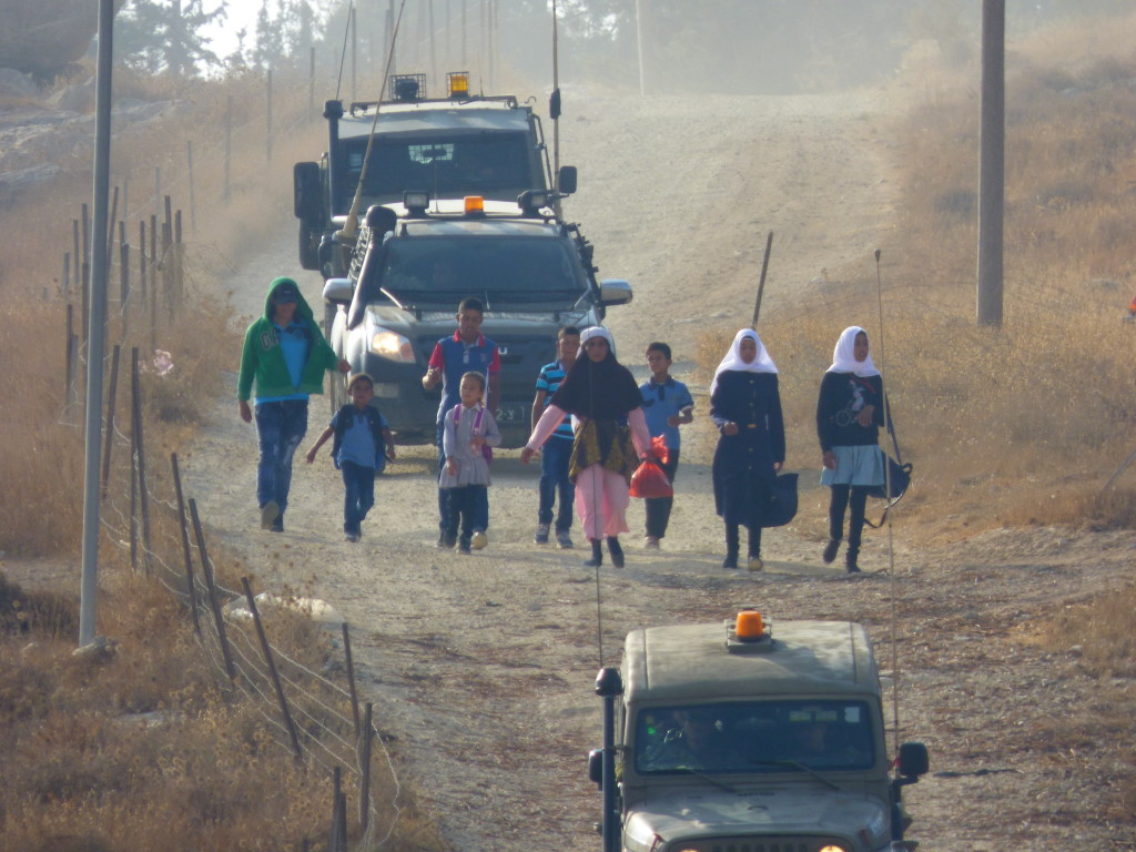 Schoolchildren reaching the Palestinian village of At Tuwani, where the school is situated.
