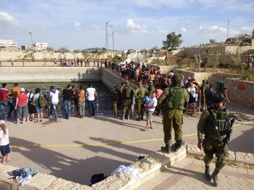 Settlers swimming escorted by Israeli forces