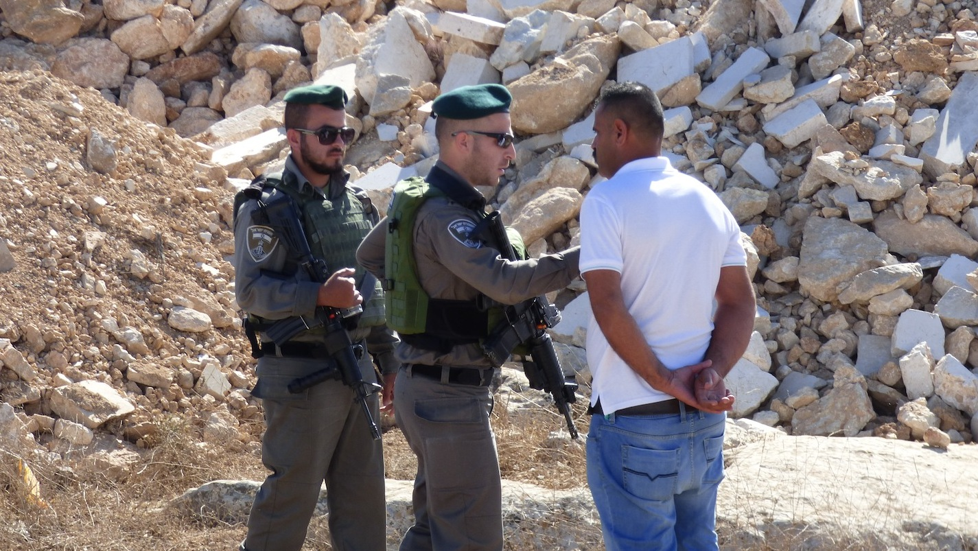 Israeli Border Police prevent the Palestinian owner from entering the building site
