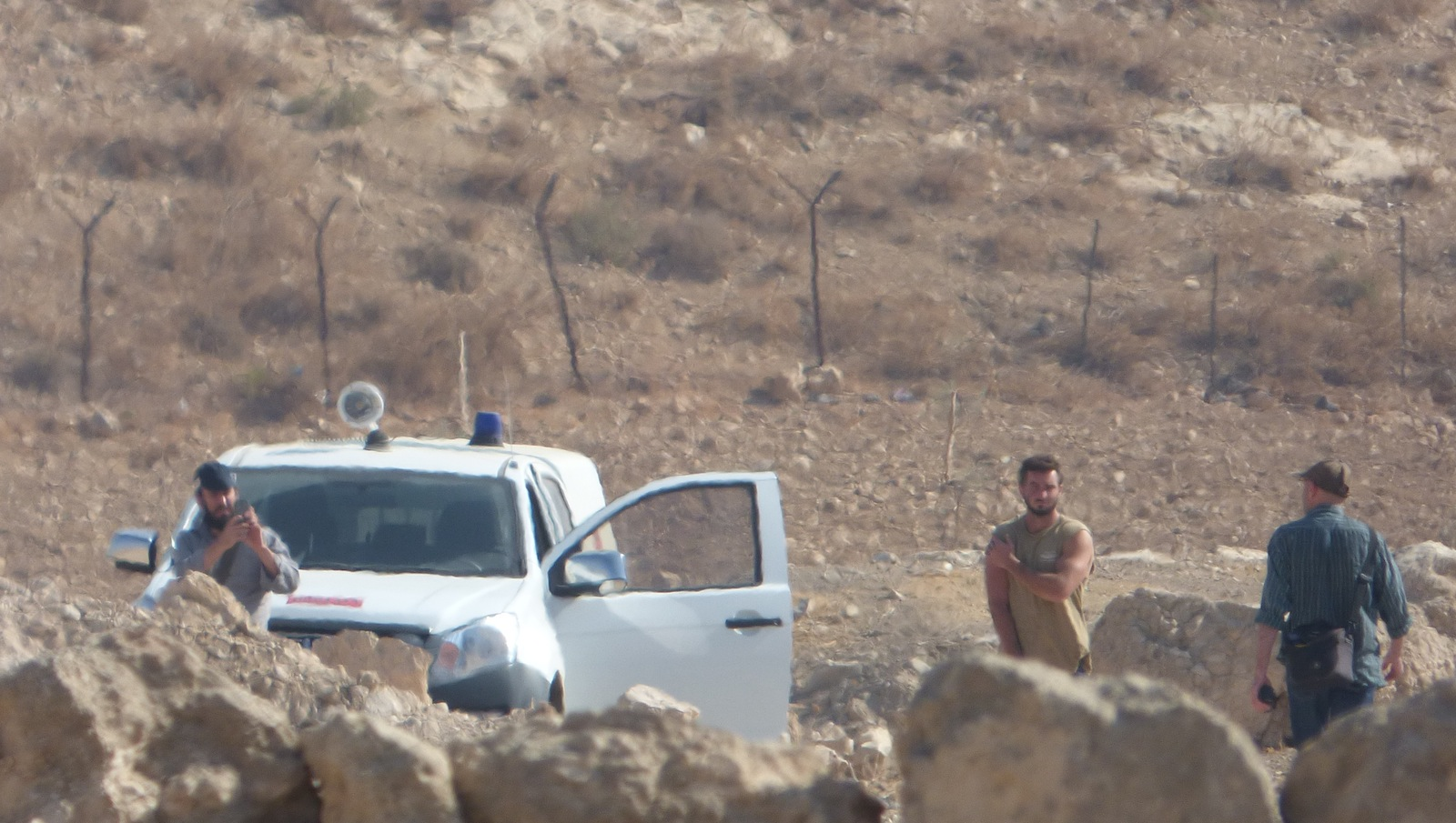 Israeli settlers in the entrance of Jinba Palestinian village