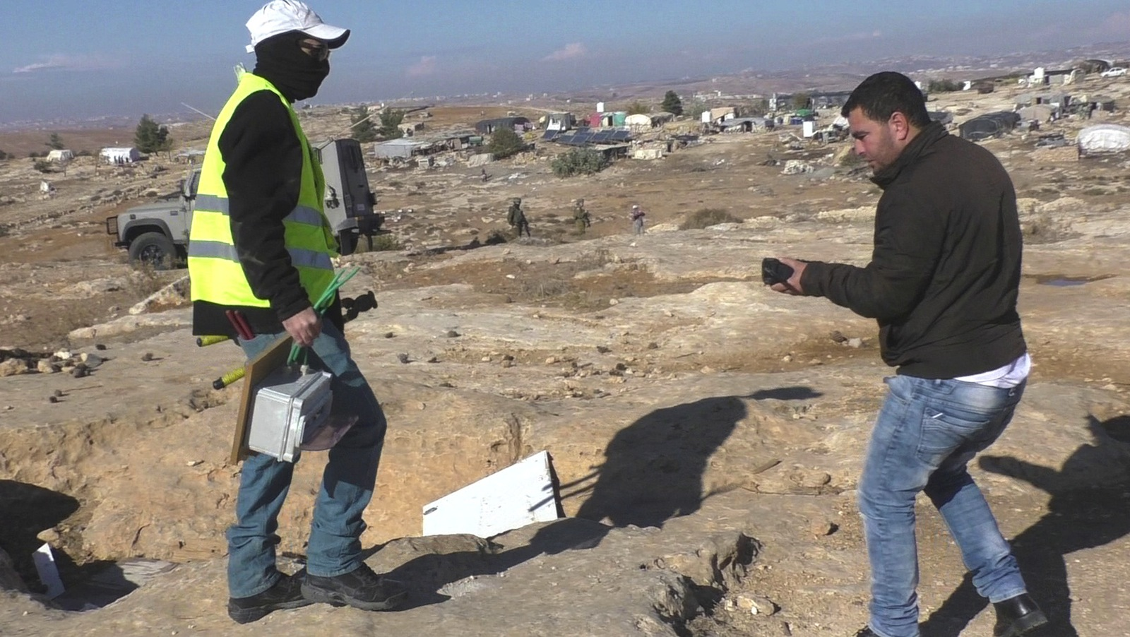 Israeli masked worker confiscates electrical control box