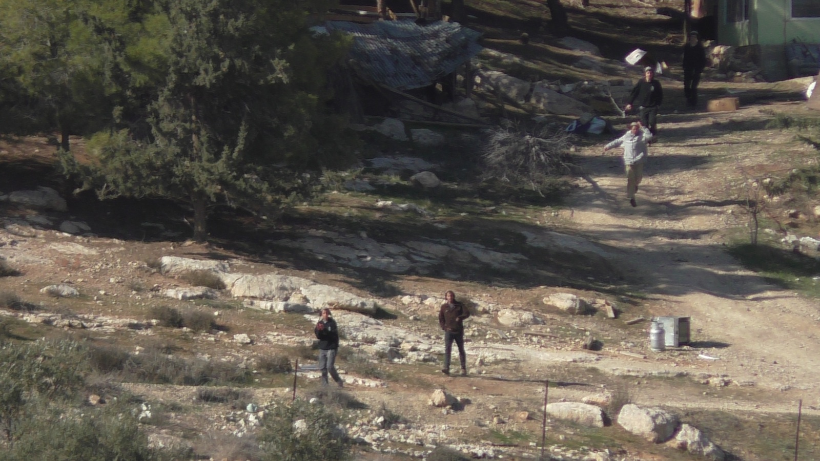 Israeli settlers coming out running from Havat Ma'on illegal outpost