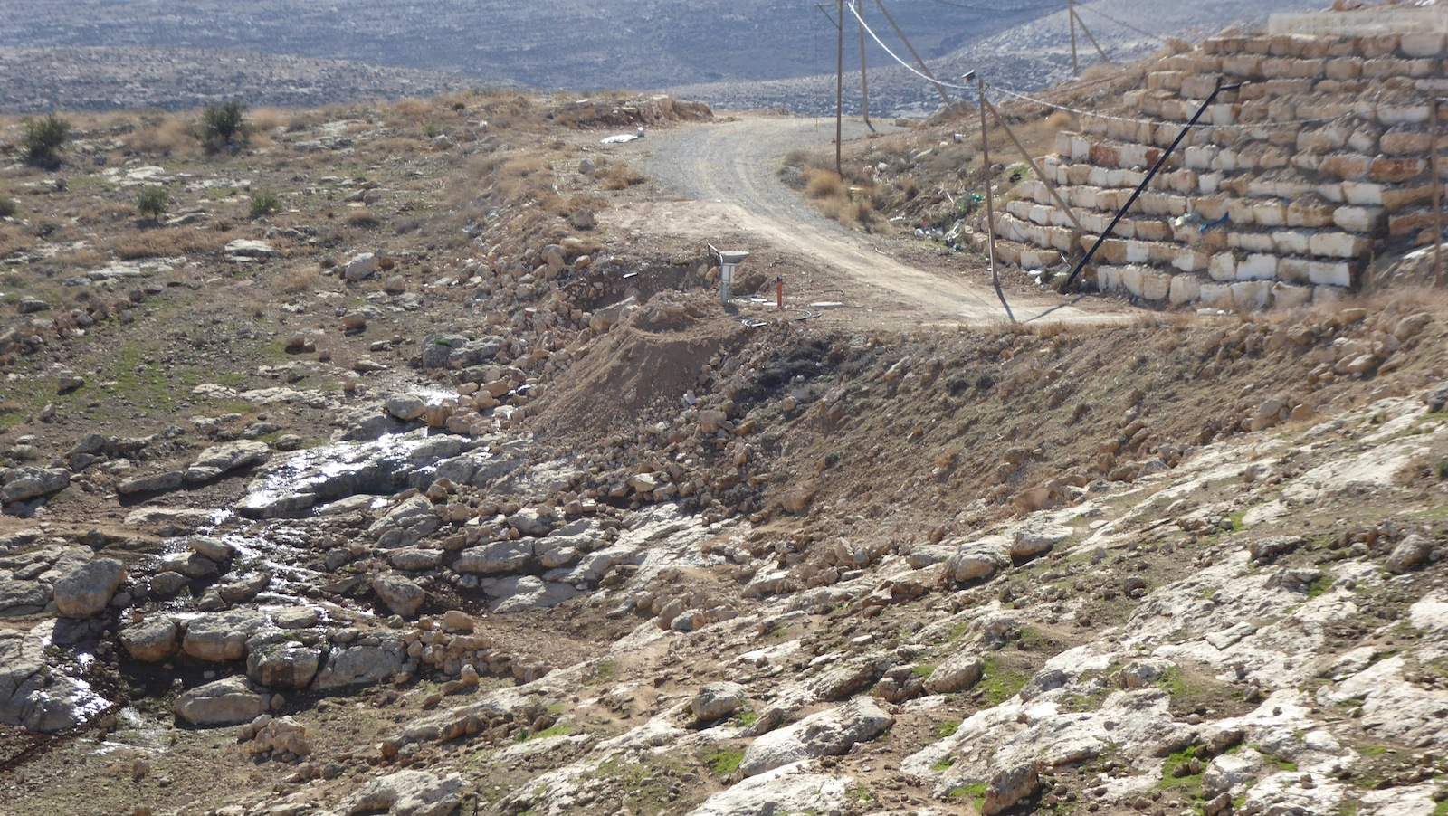 Karmel settlement's sewage system drains in the Palestinian farmland
